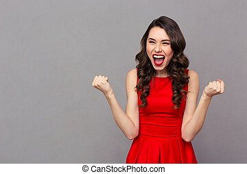 Cheerful woman celebrating her success - Portrait of a...