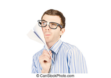 Business man devising trajectory with paper plane -...