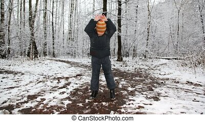 Happy boy dances against winter wood, time lapse, camera...