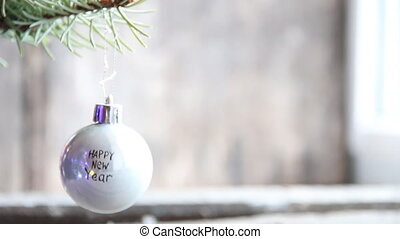 Inscription happy new year - Christmas tree branch with ball...