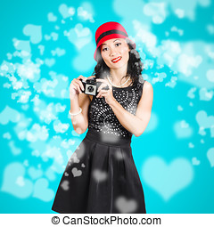 Young woman holding retro camera on blue - Young woman...