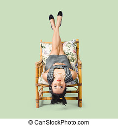 Girl having fun hanging upside down - Pinup girl having fun...