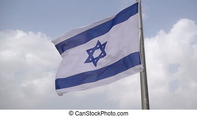 Israeli flag waving on the wind in slow motion