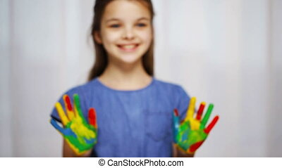 smiling girl showing painted hands - education, school,...