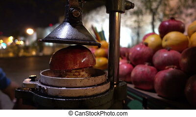 Making pomegranate juice by street seller