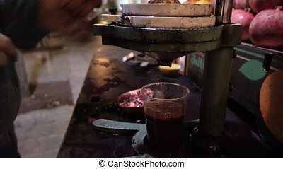 Making pomegranate juice by street seller .
