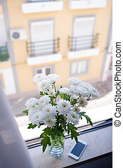 fresh chrysanthemum in vase on the window sill