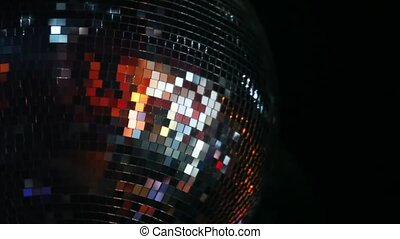 mirror-ball rotates on ceiling in night club