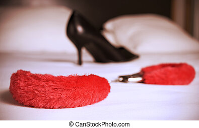 sexy fluffy handcuffs and high heeled shoe, filtered -...