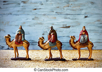 the three kings in their camels carrying their gifts for the...