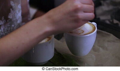 Making coffee barista education - Barista prepares couple of...