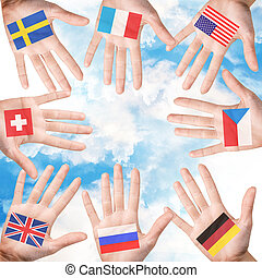 Woman hands with countries flags isolated on white...