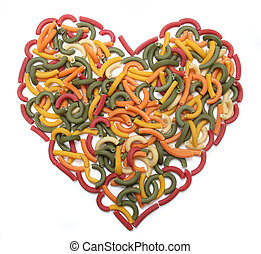 Heart of Pasta - Multi coloured macaroni heart background on...