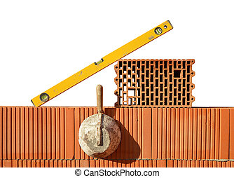 Masonry tools on red brick wall Bricklaying work