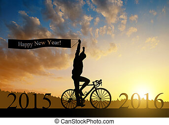 Forward to the New Year 2016 - Cyclist on bicycle at sunset...