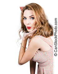 Quirky portrait of a posing 50s girl in pinup style