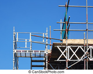 Scaffolding tower - View of scaffolding tower against blue...