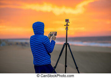Photographer filming time lapse video - Young female...