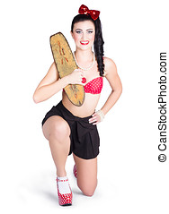 A pin up girl holding a little wooden skateboard - A young...