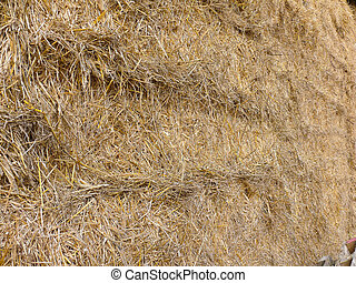 Straw bales piled
