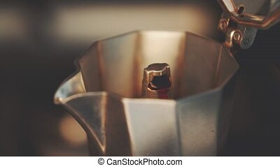 Boiling coffee in Italian coffeepot, high quality 4K...