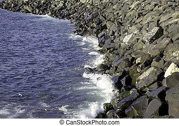 Breakwater - View of breakwater with sea waves