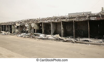 Burnt by fire market - result of the military conflict in...