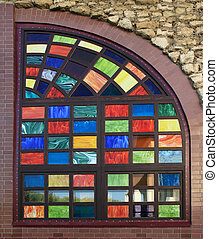 Texture of the old multi-colored stained-glass windows,...