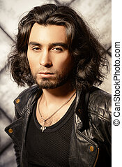 latino man - Stylish man in leather jacket over grunge...