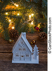 White christmas house close up with fir tree and defocused...