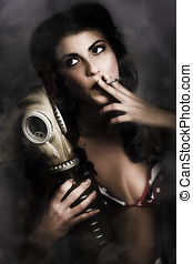Vintage army pinup girl holding gas mask - Historic portrait...