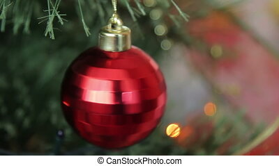 red Christmas ball,Christmas toy - red toy hanging on a...