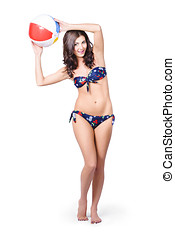 Fit and active girl in bikini with beach ball - Full body...