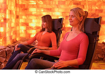 Two women relaxing in a salt cave at Halotherapy - Two women...