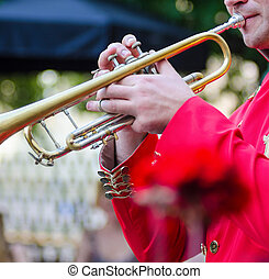 trumpet player, outdoor - a trumpet player, with blured...