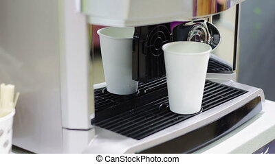 Automatic Coffee machine working and produces coffee in the...