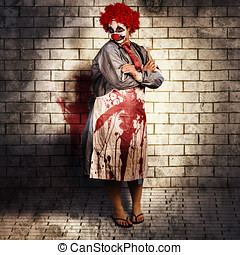 Murderous monster clown standing in full length on brick...