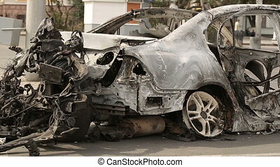 Car Burned After Explosion - result of the military conflict...
