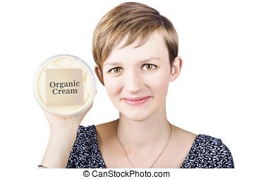 Pretty woman holding a tub of Organic Cream - Pretty healthy...