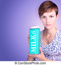 Serious woman holding low fat milk carton - Woman with...