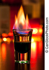 Flaming cocktail - Burning cocktail in shot glass on a...
