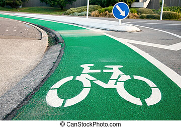 Bicycle lane - Empty green cycle track with bike lane sign