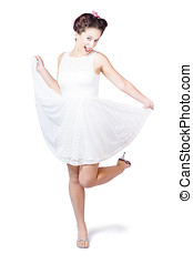50s pinup woman in white dress dancing - Young happy 50s...