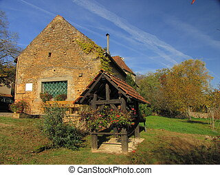 House, well - Valley of Dordogne