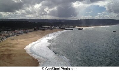 Scenic view of Nazare town and beach from overlooking cliffs...