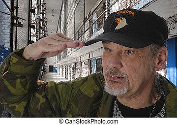 Saluting Veteran in Prison - Closeup of a old veteran in...