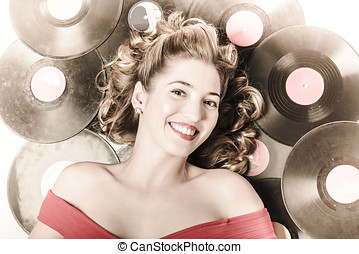Retro pin-up woman with rocking hairstyle laying down some...