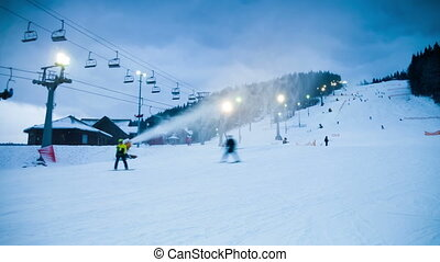 Night skiing at the ski slopes and snow cannons Timelapse -...