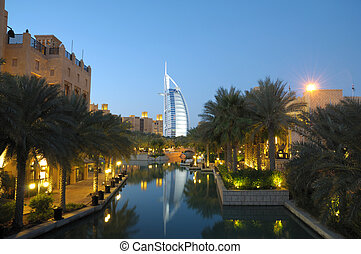 Madinat Jumeirah and Burj Al Arab at night. Dubai United...