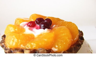 cake with fruit, rotates